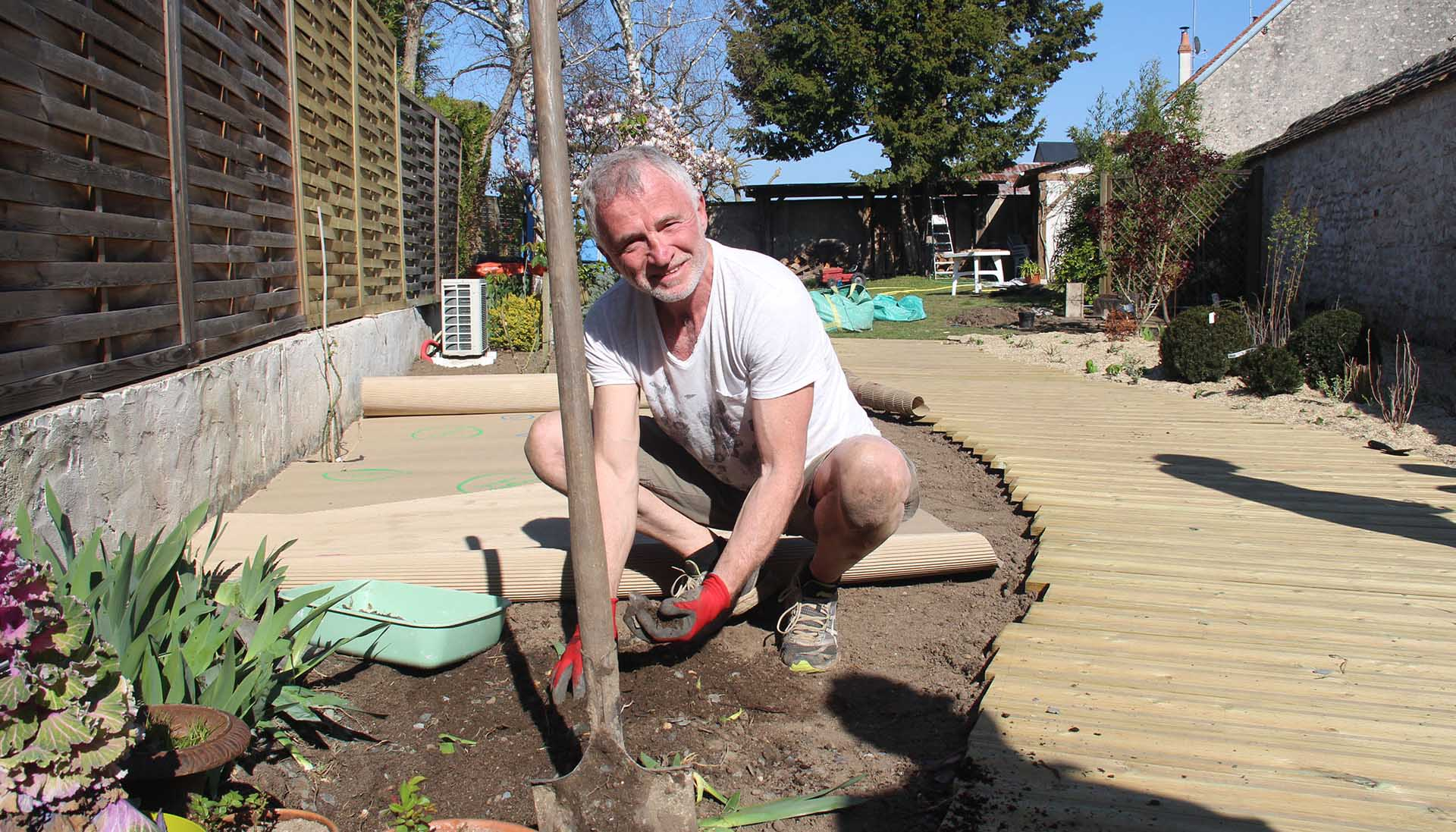 Man planting his own landscaped garden